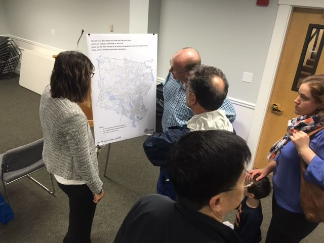 Residents viewing a map of Framingham.