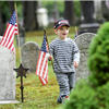 Image of a boy holding the American Flag