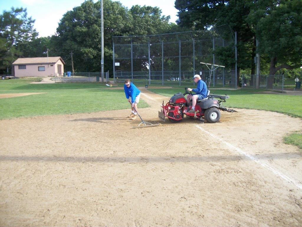 Image of Parks employees maintaining ball field