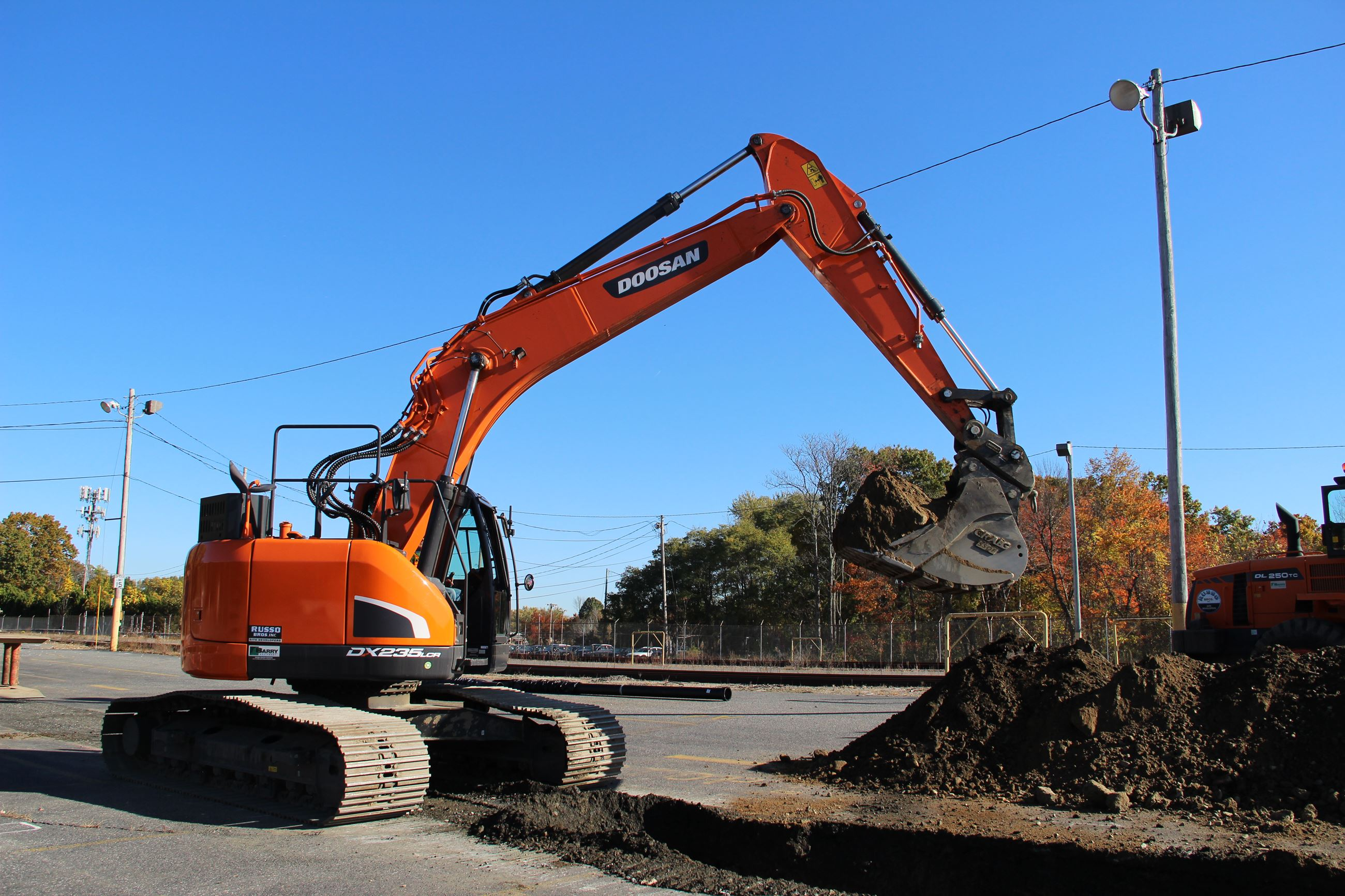 Excavator digging a trench for new water main