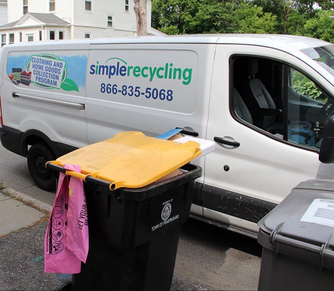 Photo of Simple Recycling Van and pink bags attached to a Framingham Public Works recycling toter.