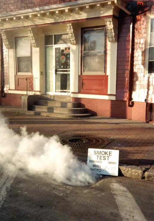 catch basin tied into sewer system - smoke testing - smoke coming out from drain structure